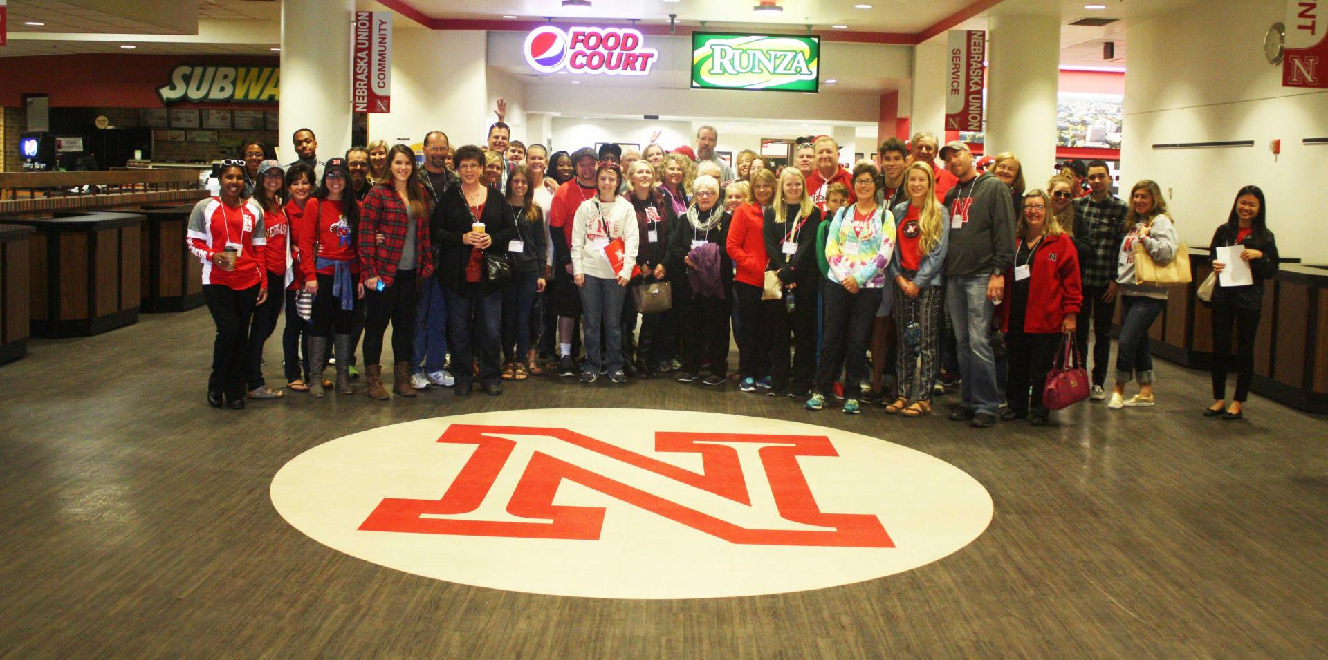 Participants from 2015 Parents Weekend meet in the Nebraska Union