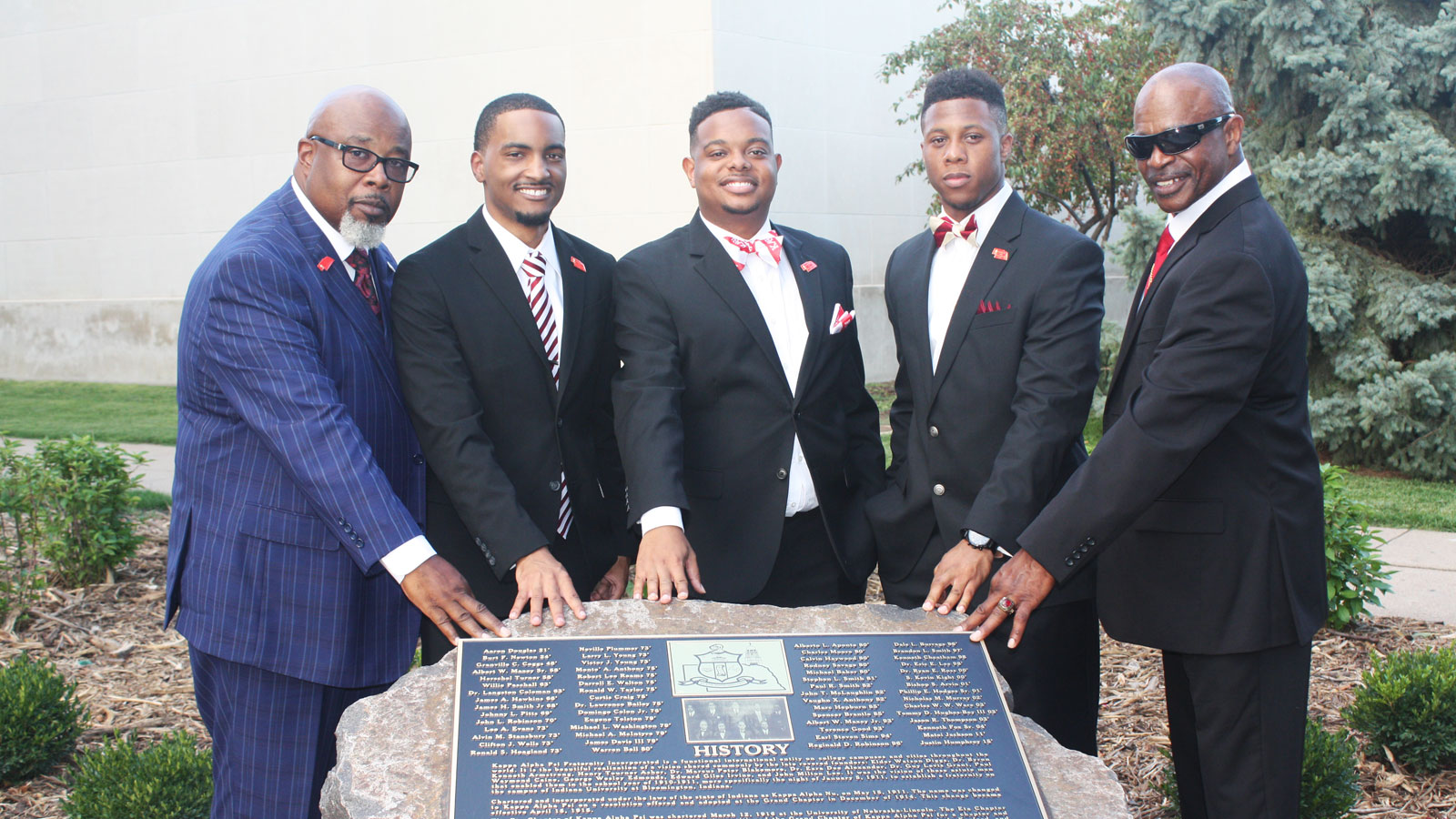 Members of Kappa Alpha Psi with new rock