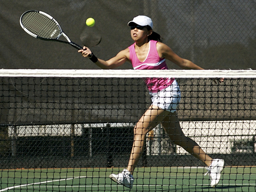 Female student plays tennis through intramural sports at the University of Nebraska-Lincoln