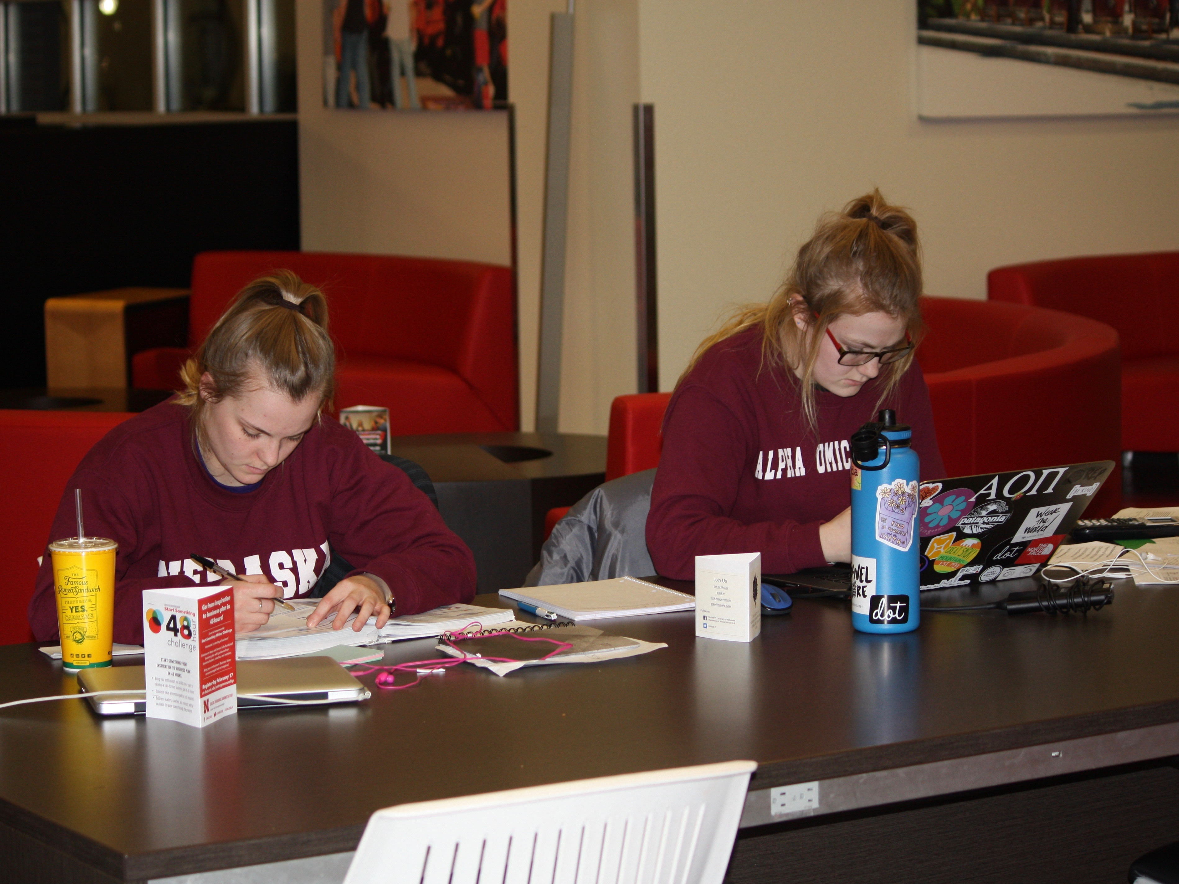 Members of Alpha Omicron Pi study in the Nebraska Union.