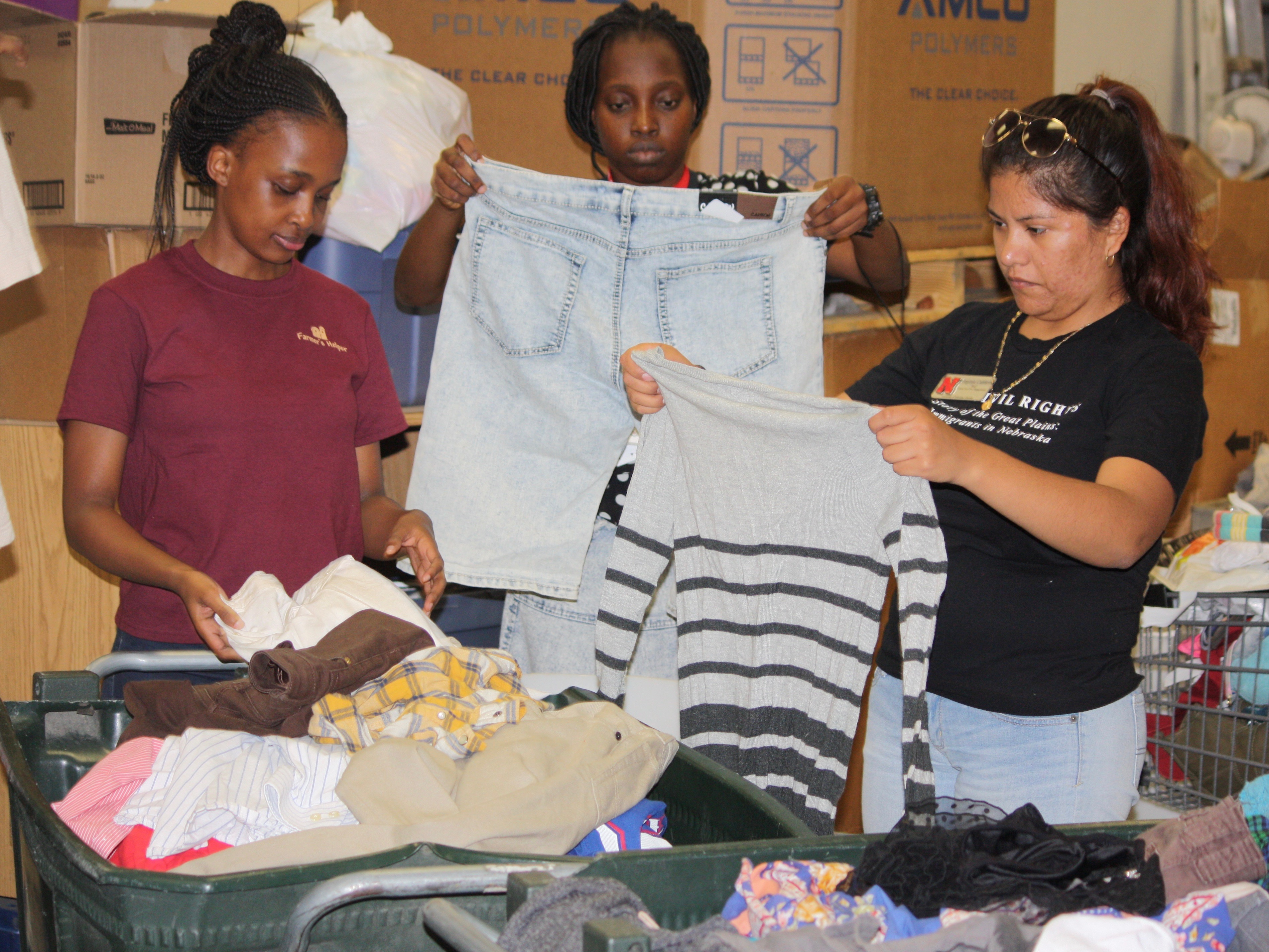 Participants in the Mandela Fellows program sort donations to the Homeless Prevention Center.