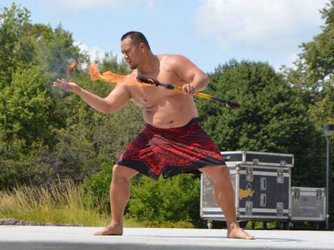 Polynesian torch dancer at University of Nebraska-Lincoln OASIS Kickoff event on Aug. 27, 2017.