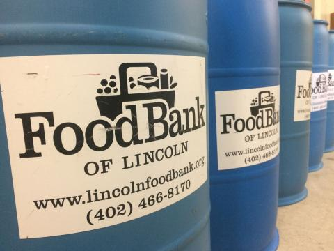 Students load donation barrels to give back to the Lincoln community