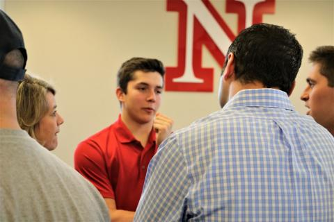 A Nebraska fraternity member answers questions for potential members and their parents at Greek Preview.