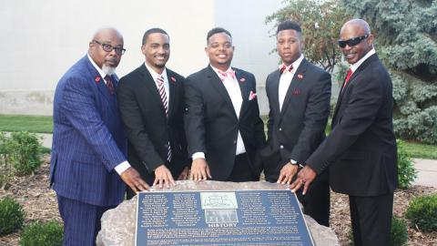 Members of Kappa Alpha Psi fraternity with new rock located south of the Nebraska Union