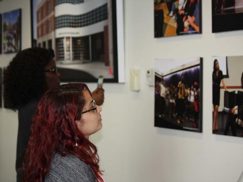 Student looks at photo in Mandala Lounge