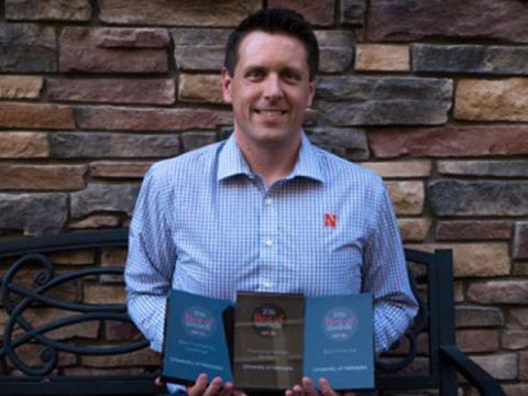 Tony Rathgeber with awards